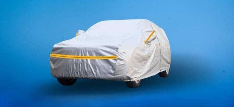 Covered car with a blue background.
