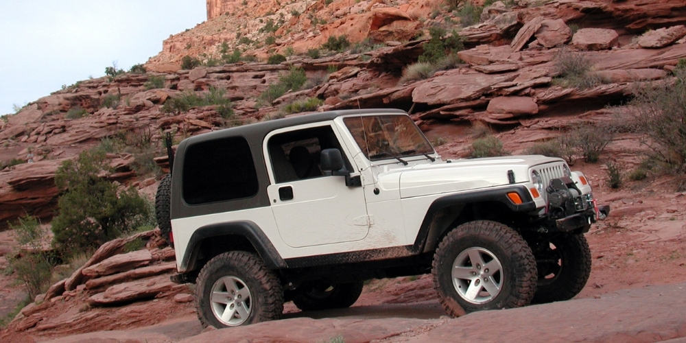 Best Jeep Accessories - Black and white jeep on a rocky hills.