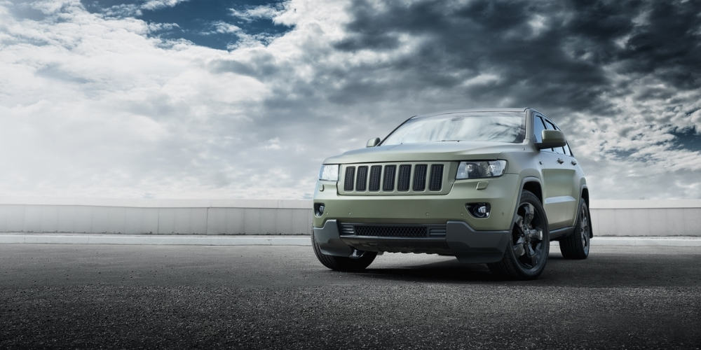 Jeep Grand Cherokee in an open field.
