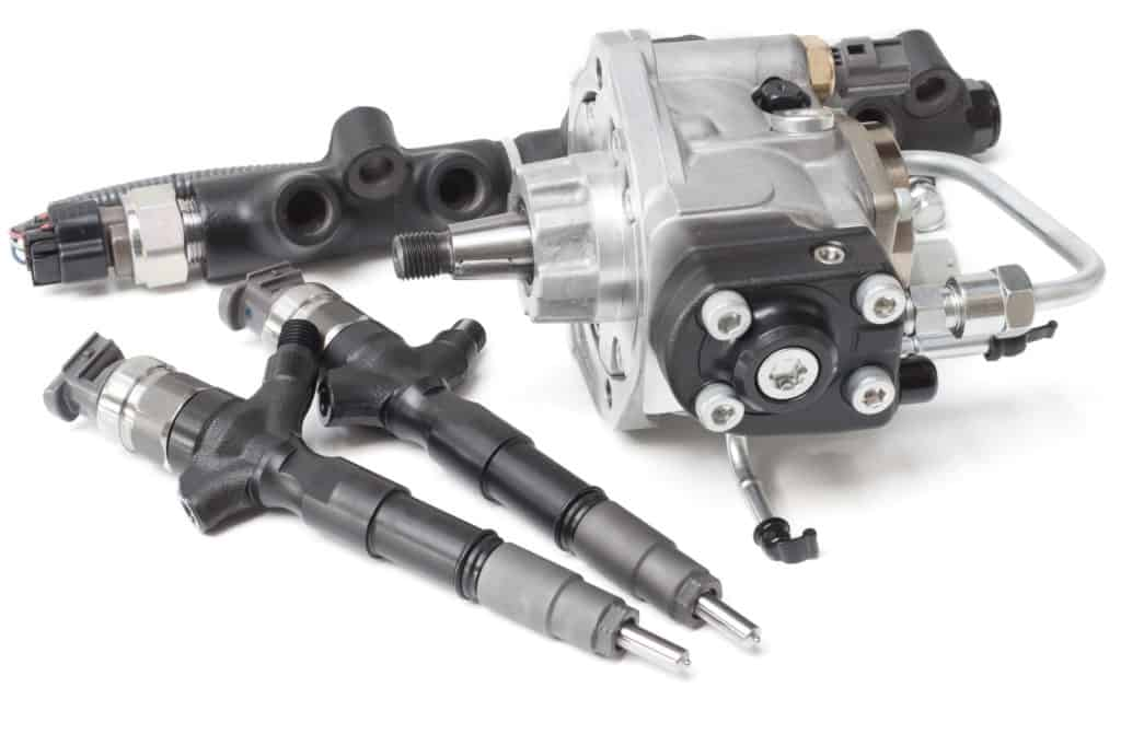 New solenoid injectors for diesel fuel lying on a white background