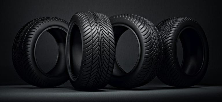 Four tires in black background