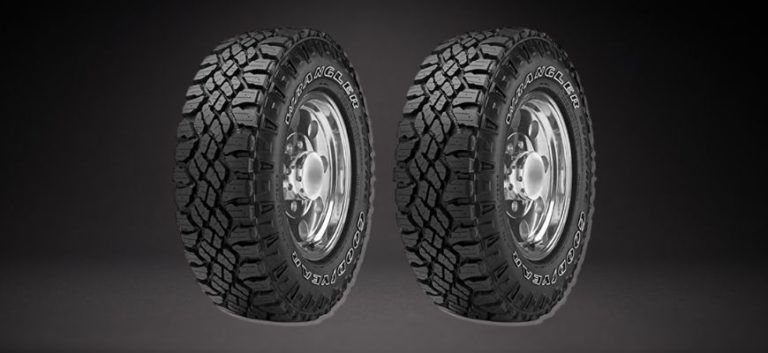 Two tires in black background