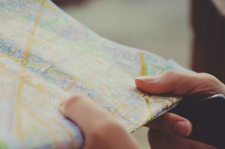Person's hand holding a map